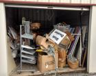 Contents Of Storage Unit:  Retail shelving, peg board & shop lights