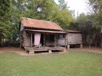 Approximately 38' x 15' antique log cabin with 7' - 17' porch