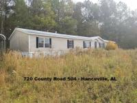 DOUBLE-WIDE MANUFACTURED HOME ON 0.91 ACRE± LOT; Address of 100 County Road 5000 in Hanceville