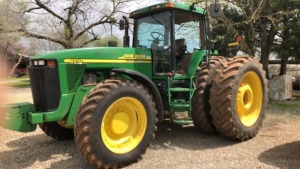 John Deere 8210 Tractor, MFWD, C/A/D, dual wheels; S# 3123; 6709 hrs (TRACTOR & EQUPMENT HOURS LISTED IN DESCRIPTIONS & PICTURES ARE NOT GUARANTEED.  PLEASE INSPECT EACH PIECE YOU ARE INTERESTED IN PERSONALLY.)