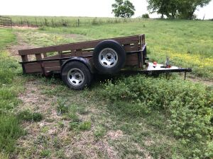 "6'4"" × 10' Tilt Trailer w/spare tire & side boards"