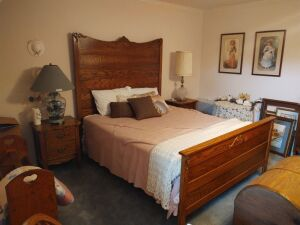 "Vintage Oak Full Size Bed With Bedding (headboard=71"" tall x 65"" wide; footboard=32"" tall)"