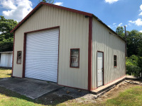 24' x 30' Metal Building With 12' x 12' Garage Door. To be moved from its current location at the sole expense of the Buyer within 30 days.