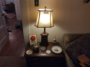 "Table Lamp (26"" tall), Ashtrays, Votive Candle, Decorative Bell, Display Plate & Print On Easel"