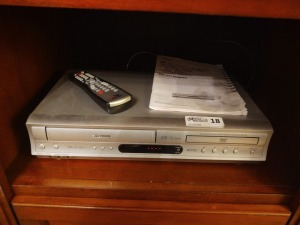 Toshiba DVD/VHS Player With Remote, Guide & VHS Movies