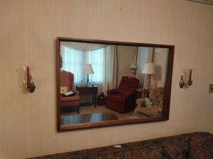 Framed Wall Mirror & A Pair Of Wall Hurricane Lamps