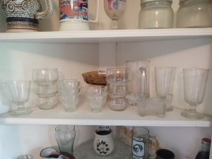 Contents of Second Shelf in Corner Cabinet:  Glassses & Small Bowls