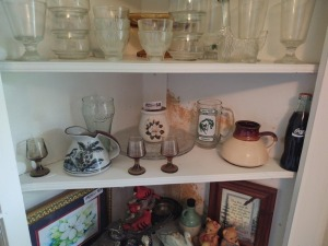 Contents of Third Shelf in Corner Cabinet Including Pitcher, Glasses & Coca Cola