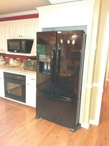 Whirlpool Refrigerator side by side with  pull out freezer door; Model #: GI6FARXXB03, S/N: K14901356