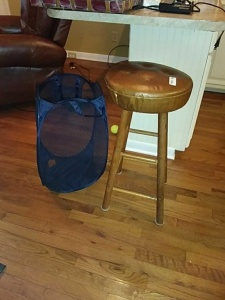 Bar stool & mesh laundry bag with rip in the bottom