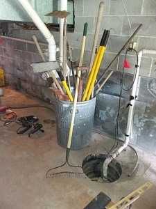 Trash can and assortment of yard tools