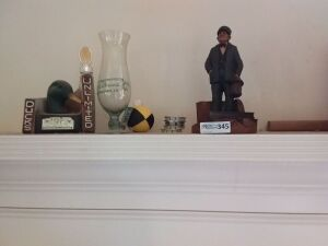 Contents Of Mantle:  Ducks Unlimited Trophy, Hurricane Glass, Man Figurine
