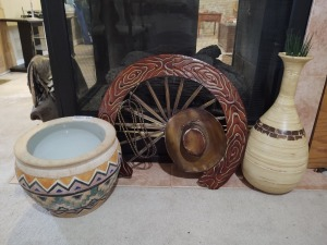 "Large decorative planter (10"" tall), decorative vase (20"" tall), decorative metal wagon wheel with cowboy hat & rope"