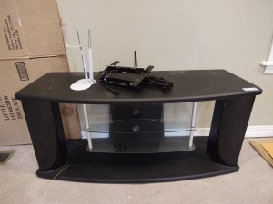 "Black TV stand with 2 glass shelves (44""long x 15""wide); orbital tv mount"
