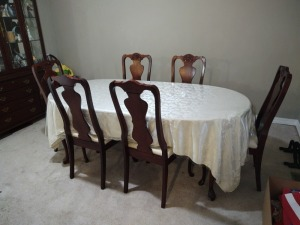 Large dining room table and 6 padded chairs