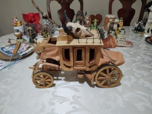 Decorative wooden stagecoach with decorative skull