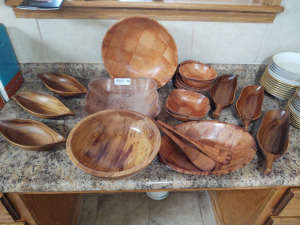 Large assortment of various size wooden bowls