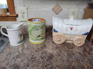 Western décor wagon cookie jar filled with playing cards, utensil holder & measuring pitcher