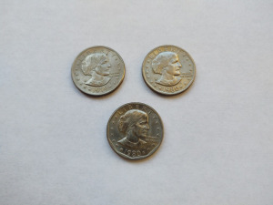 (3) SUSAN B. ANTHONY ONE DOLLAR COINS (2 ARE 1980 & 1 IS 1979)