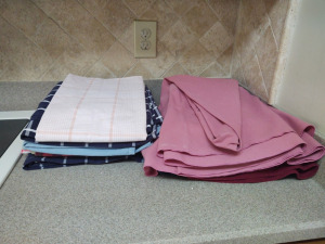 "ASSORMENT OF TABLECLOTHS (70"" ROUND, 54"" SQUARE)"