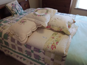 White Quilt With Floral Design & Pillows