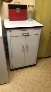 White metal cabinet with contents