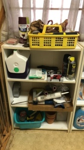 Shelf with contents; tools, small cooler, etc.
