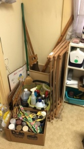 Contents of laundry room corner; drying rack, yard sticks, hand saw, etc.