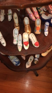 Contents of 3-tiered wooden stand; miniature shoes