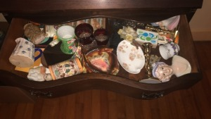 Contents of drawers of Secretary desk; assortment of items