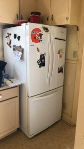 Whirlpool side by side refrigerator with freezer on the bottom