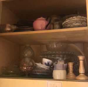Contents of Cabinet:  Cups, Plates, Creamer, Candlestick Holders