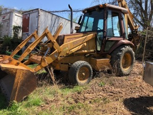 Case 580 Super K Back Hoe With Cab, runs
