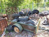 Small Utility Trailer Filled With Tires