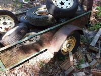 Small Utility Trailer Filled With Tires - 2