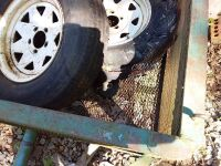 Small Utility Trailer Filled With Tires - 4