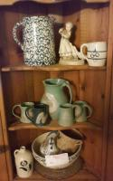Contents of Curio Cabinet (Lot #9):  Pitchers, Figurine, Mug & Baskets